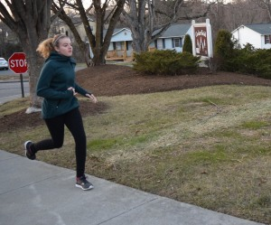 Blacksburg, Va., Feb. 5- Running despite the cold: Erin Newman runs in her neighborhood on chilly afternoon. It is about 45 degrees so she opted for running tights and a jacket.