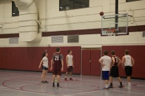 Blacksburg, Va., Feb. 23 - Free Throw: Players watch as no. 23 on maroon shoots a free throw. Photo: Johnny Kraft