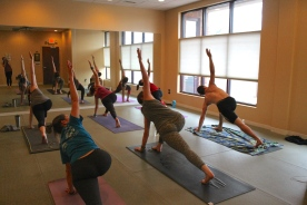 Blacksburg, Va., Feb. 14 - Lunge Variation: Students practice a lunge variation. For practitioners who have trouble touching the floor with these poses, blocks may be used to modify and assist. Photo: Haven Lewis