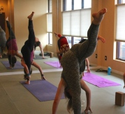 Blacksburg, Va., Feb. 14 - Standing Split: Students practice the Standing Split pose. This pose is challenging, but will improve one's balance over time. Photo: Haven Lewis