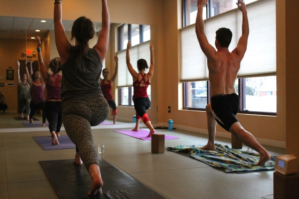 Blacksburg, Va., Feb. 14 - Crescent Variation: Students at InBalance Yoga practice their High Lunge, Crescent Variation poses. This pose opens the hips and strengthens the legs, knees, ankles, and waist. Photo: Haven Lewis