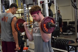 Blacksburg, Va., Sept. 6- LIFTING: C.J. Carroll engages in off-season weight lifting sessions. Photo: Blayne Fink