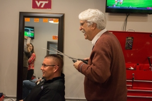 Blacksburg, Va., Feb. 1 - Mayor Fun: The Mayor of Blacksburg Ron Rordam has a little fun with the ceremonial big scizzors as he pretends to cut a customer's hair. Photo: Stephen Dixon