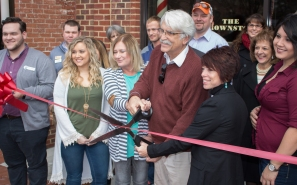 Blacksburg, Va., Feb. 1 - It's Official: Brownstone Barber Shop officially announces it's opening as Mayor Ron Rordam cuts the ribbon in front of the business. Photo: Stephen Dixon