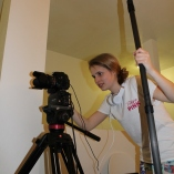 """Blacksburg, Va., Feb. 23 – The Set-Up: Sophomore Madison Hummel checks sound and sets up a shot before filming for her movie, """"Social Media(nxiety)."""" """"Crafting stories through art is a wonderful tool to make audiences laugh or move them to make changes in our world,"""" Hummel said. Photo: Caitlyn Murray."""