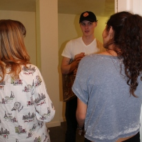 Blacksburg, Va., Feb. 23 – Action: Actors Untiedt (left), Danny Purcell (center), and Mavromatis (right) film a scene where the dreamy pizza delivery boy intrudes on a girl's night. Each actor is in at least two other films this semester. Photo: Caitlyn Murray