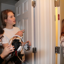 Blacksburg, Va., Feb. 23 – Cut: Hummel ends the scene and gives the actors direction as cinematographer, Alexis Medina (left), adjusts the shot. The cast and crew filmed from 7 p.m. until 3 A.M. Photo: Caitlyn Murray