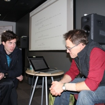 Blacksburg, Va., Feb. 29 – The Consultation: Student Miles Gheesling discusses his film's production concerns to cinema professor, Charles Dye. Photo: Caitlyn Murray