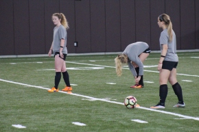 BLACKSBURG, Va., Apr. 11 - Members of the Virginia Tech women's soccer team practice while wearing black arm bands in honor of the ten year anniversary of April 16th. Photo: Conor Doherty