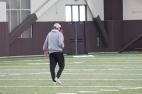 "BLACKSBURG, Va., Apr. 11 - Head Coach Charles ""Chugger' Adair watches his team practice as he walks towards them. Photo: Conor Doherty"