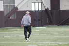 "BLACKSBURG, Va., Apr. 11 - Head Coach Charles ""Chugger' Adair watches his team practice as he walks towards them. Photo: Conor Doherty"