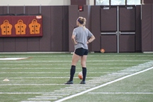 BLACKSBURG, Va., Apr. 11 - A member of the women's soccer team watches as her teammates take part in a drill during practice. Photo: Conor Doherty