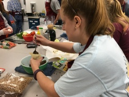 Blacksburg, Va., April 3- World Crops: Junior Courtney Pooton cooks with lentils in the World Crops Food Lab. Pooton plans to work with the USDA and her sixth generation family farm after graduation. Photo: Katie Lukens