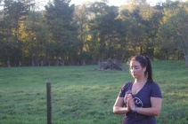 Blacksburg, Va., Sept. 28—Namaste: Cici Sobin takes a moment when the goats have wandered off to other people. Photo: Virginia Pellington