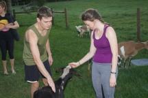 Blacksburg, Va., Sept. 28—Greetings: Virginia Tech students, Brendan and Lisa, greet the goats before their class beings. Photo: Virginia Pellington