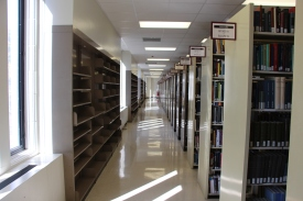 Blacksburg, Va., Oct. 22 - Shelves Versus Space: Packed bookshelves juxtaposed with empty bookshelves at Newman Library. As books and bookshelves, there could be more space for students to collaborate. Photo: Humberto Zarco