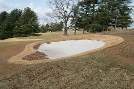 BLACKSBURG, Va., Feb. 15 - Sand is placed in the holes before grass seeds are planted in order to avoid mud pools after rain or snow. Photo: Alexis Walsh