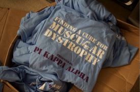 Blacksburg Va., Oct 2 - CAMPAIGNING FOR A CURE: One of Lefkowitz's personal attendants, Tony Fisher, was so inspired by his experience that he campaigned for Homecoming King while promoting muscular dystrophy research. Boxes of the T-shirts he made remain in Lefkowitz's room.