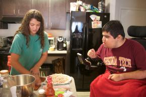 Blacksburg Va., Oct 2 - BON APPETIT: Personal attendant, Alexa Rose, serves up dinner for Lefkowitz. She is making his favorite appetizer, buffalo chicken dip.