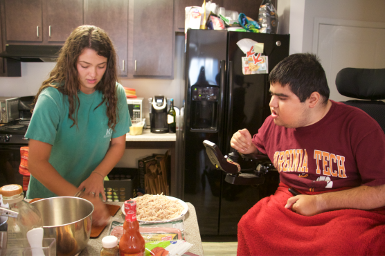 Blacksburg Va., Oct 2 - BON APPETIT: Personal attendant, Alexa Rose, serves up dinner for Lefkowitz. She is making his favorite appetizer, buffalo chicken dip.