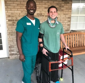 Blacksburg, Va., March 2017 - Recovery: Elmer stands with one of the physical therapists that helped him regain his ability to walk. Photo courtesy of Chris Elmer.