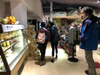 Blacksburg, Va. Feb.19, Grab and Go - Here a student examines his food options in the Grab and Go section of West End Market. Many of the options on the shelves are vegan. Photo by: Tatjana Kondraschow