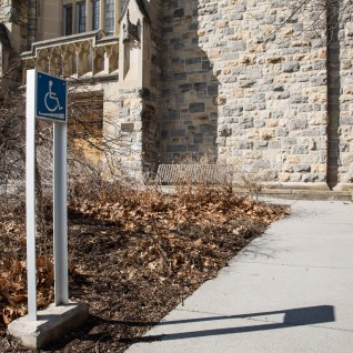 Blacksburg, Va., Feb. 18 — ROBESON RAMP: This handicap ramp leads into Robeson Hall. A tall and visible sign directs the way. Photo: Loren Skinker.