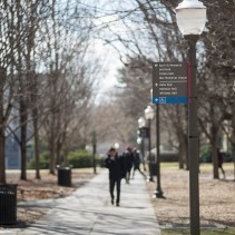 Blacksburg, Va., Feb. 18 — LAMPPOST SIGN: Campus is filled with handicap signs. Even lampposts, like this one outside of Pamplin Hall, contains directions to the nearest ramp. Photo: Loren Skinker.