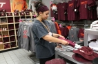 Blacksburg, Va., March 4 - Folding Clothes: Folding and restocking clothes is also a responsibility for those working an on campus job.