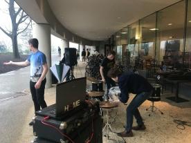 Blacksburg Va., April 12 — THE SHOW MUST GO ON: The Noodle sets up their equipment despite the heavy rains. Photo: Gretchen Kernbach