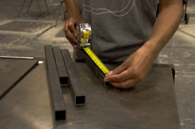 Blacksburg, Va., April 19 - Measuring Metal: Students learn skills for set-building and other projects, including metalworking. Photo: Lizzy Street